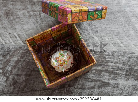 Chocolate muffin in the gift box - stock photo
