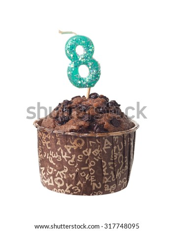 Chocolate muffin with birthday candle for eight year old isolated on white background