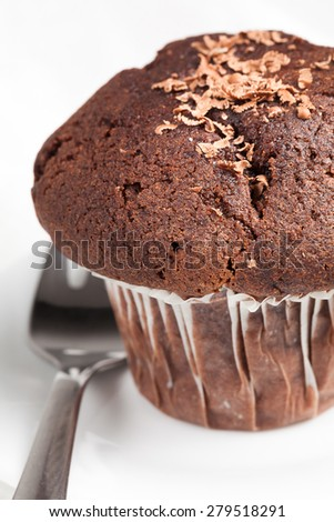 chocolate muffin with dessert fork.