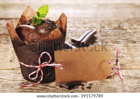 chocolate muffin with mint on a wooden table - stock photo