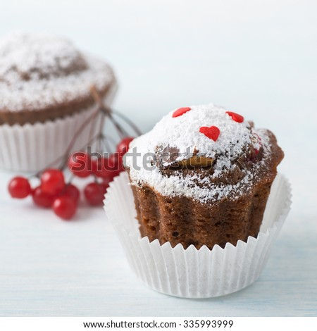 Chocolate Muffins with Berries on White Background.