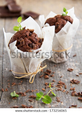 Chocolate muffins with coffee and chocolate. - stock photo