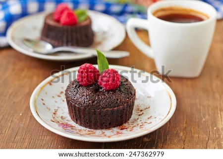 Chocolate muffins with raspberries for breakfast - stock photo