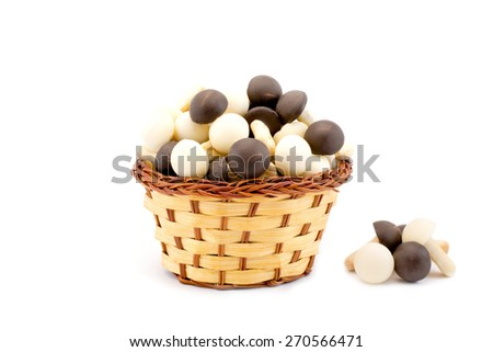 chocolate mushrooms in a basket isolated - stock photo