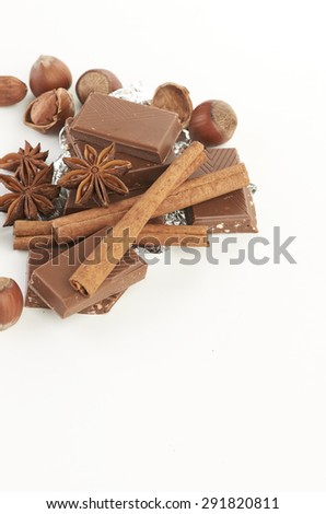 chocolate,nuts and spice - stock photo
