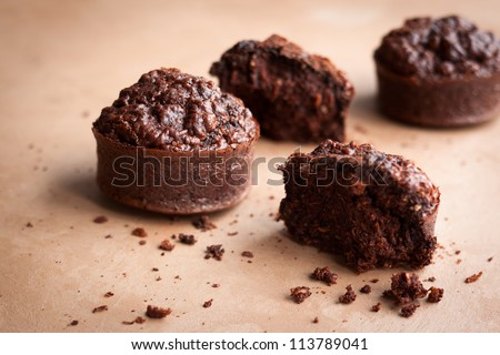 Chocolate oat bran muffins on the table - stock photo