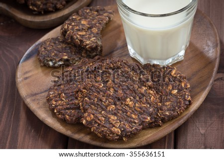 chocolate oatmeal cookies and a glass of milk, top view, horizontal - stock photo