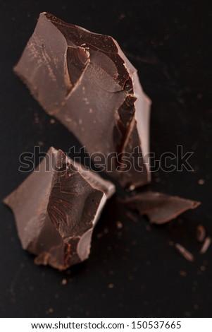chocolate on black background - stock photo