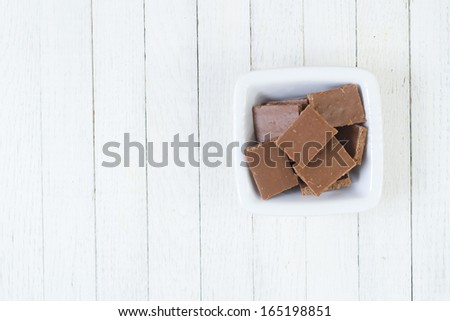 chocolate on white wooden table - stock photo