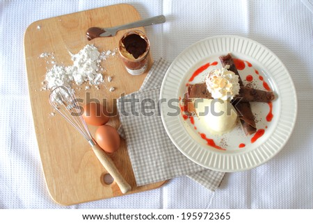 chocolate pancakes crepes with ice cream. top view - stock photo