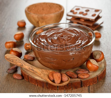 chocolate paste in a glass bowl on a brown table - stock photo