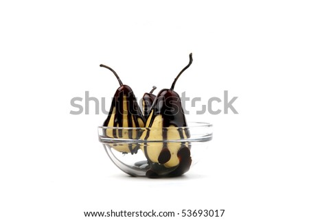 Chocolate pears isolated on white - stock photo
