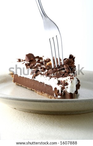 Chocolate pie and a fork - stock photo