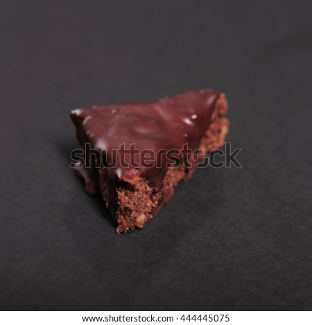 Chocolate pie on a black background