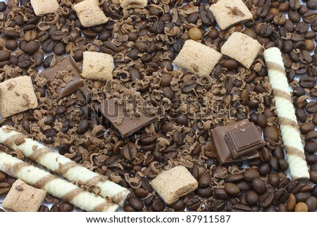 Chocolate pieces and coffee beans for background