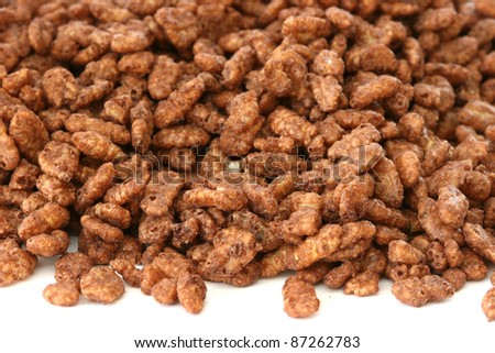 Chocolate popped rice cereals on a white background - stock photo