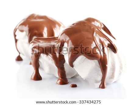 Chocolate poured on marshmallow isolated on white - stock photo