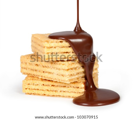 chocolate poured on Tasty waffles - stock photo
