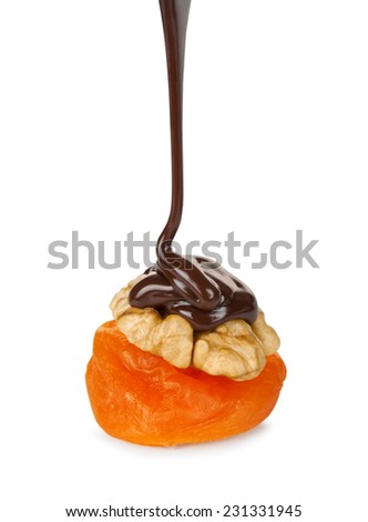 chocolate pouring on walnut and apricots isolated on white background - stock photo