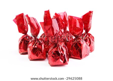 Chocolate praline in foil  on white background - stock photo