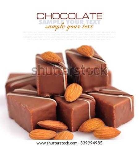 Chocolate praline with almonds on white background - stock photo