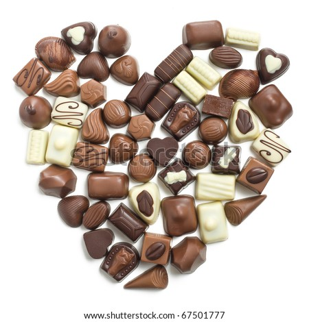 chocolate pralines heart on white background - stock photo