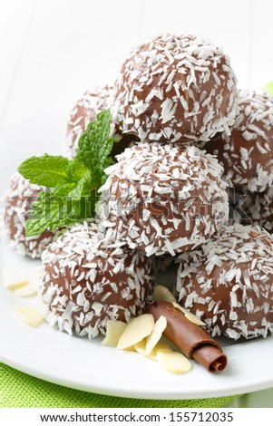 chocolate pralines with coconut and almonds - stock photo