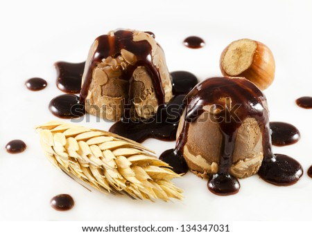 Chocolate pralines  with peanuts and cereals  on a white dish - stock photo