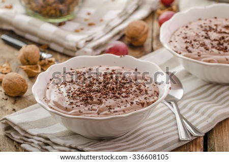 Chocolate pudding and baked granola, delicious start of day in the cool autumn - stock photo