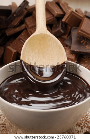 Chocolate pudding and spoon. - stock photo