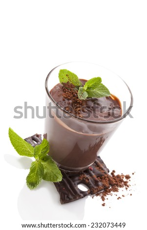 Chocolate pudding with fresh mint leaves and chocolate bar isolated on white background. Culinary sweet dessert. - stock photo