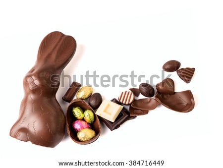 Chocolate rabbit and chocolate on white background