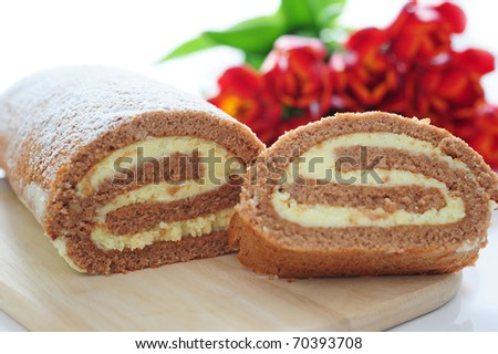 chocolate roll with white fillings - stock photo