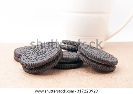 Chocolate sandwich biscuits with vanilla cream on white background