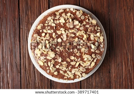 Chocolate sandwich cake garnished with flaked almonds