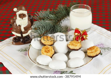 Chocolate Santa Claus with coconut and ginger cookies - stock photo