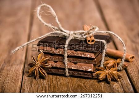 chocolate set, star anise and cinnamon sticks close up - stock photo