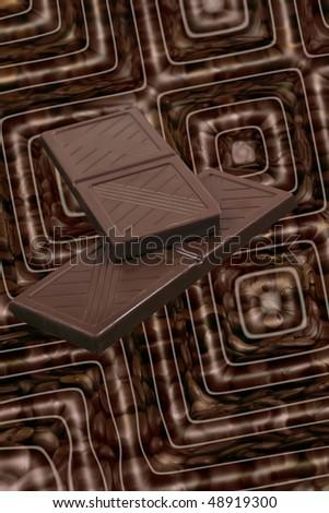 chocolate slices on coffee grains - stock photo