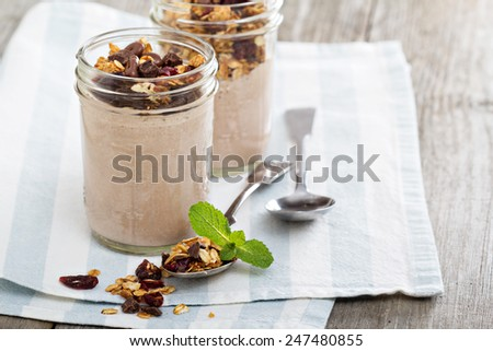 Chocolate smoothie with chocolate granola for breakfast - stock photo