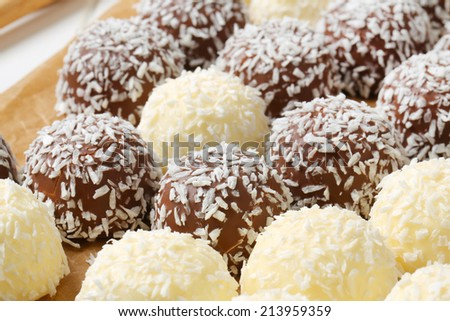 Chocolate snowball truffles rolled in coconut - stock photo
