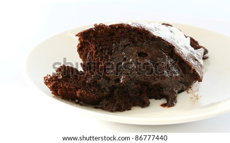 Chocolate souffle light backed cake portion on a plate - stock photo