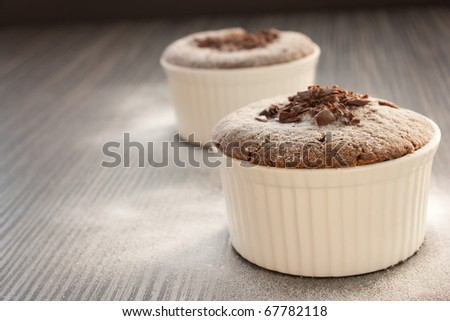 Chocolate souffle with chocolate chips and red currant - stock photo