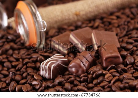 Chocolate specials on coffee beans background