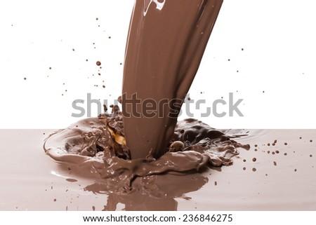 chocolate splash isolated on white background - stock photo