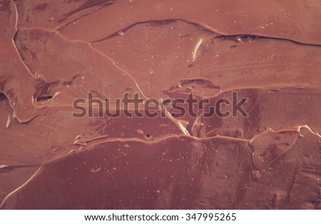Chocolate spread as background - stock photo
