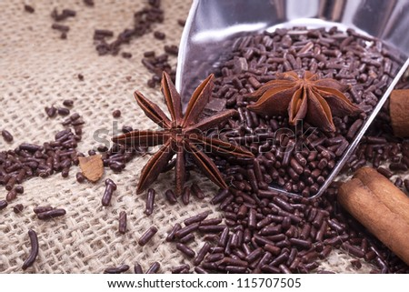 chocolate sprinkles, anise and cinnamon ingredients for christmas recipe - stock photo