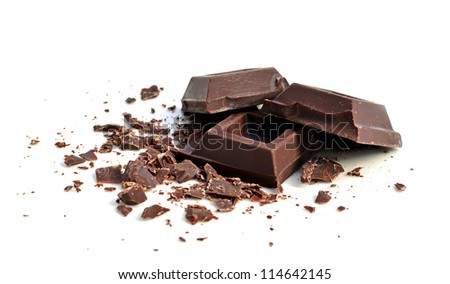 Chocolate squares and crumbles on white background