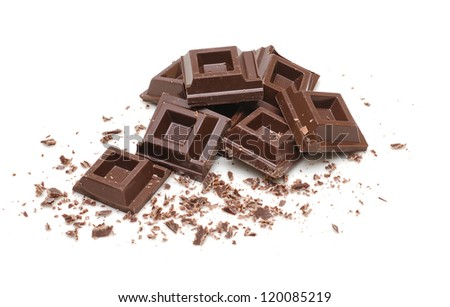 Chocolate squares and crumbles on white background - stock photo