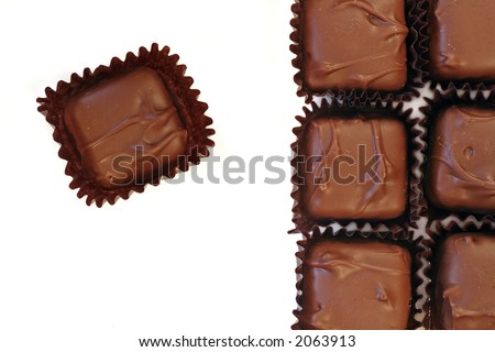 chocolate squares over white, close up - stock photo