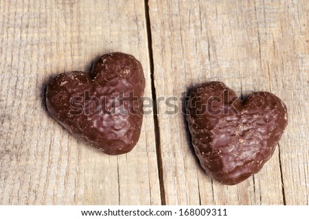 Chocolate sweet cookies heart on background of the old board. Valentine's Day  - stock photo